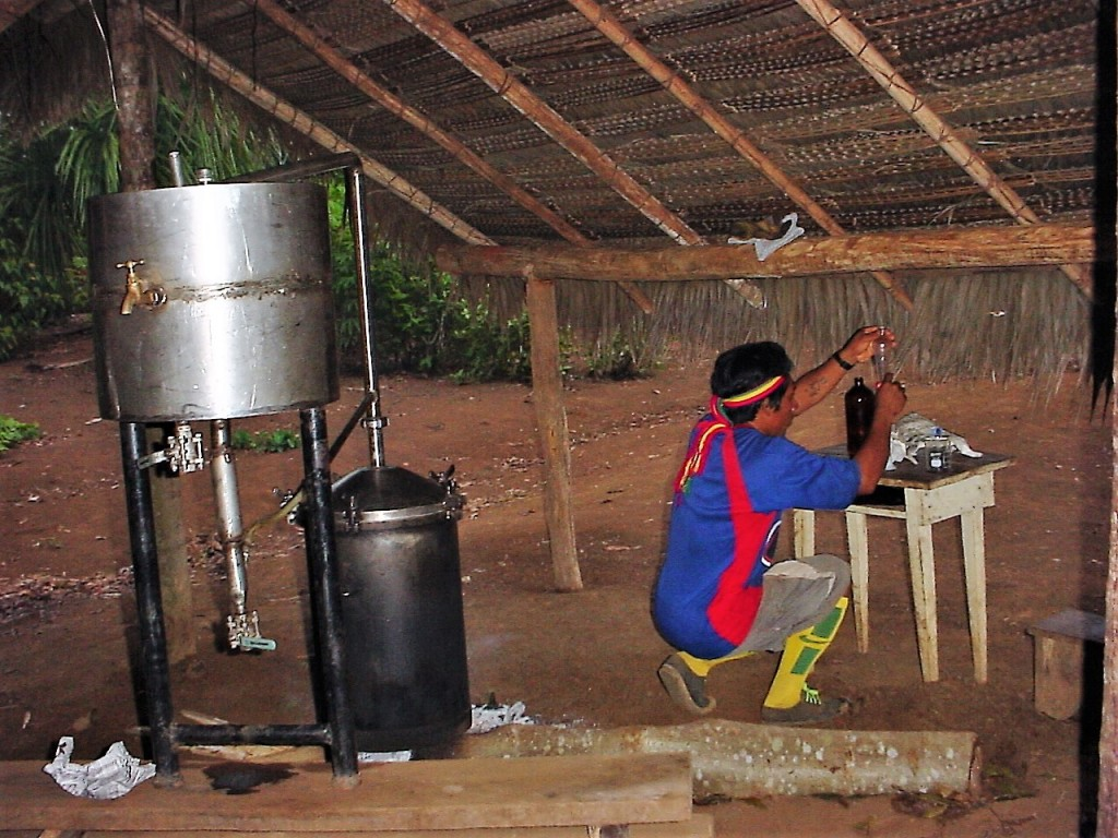 A worker purifies oil for the manufacture of indigenous cosmetics