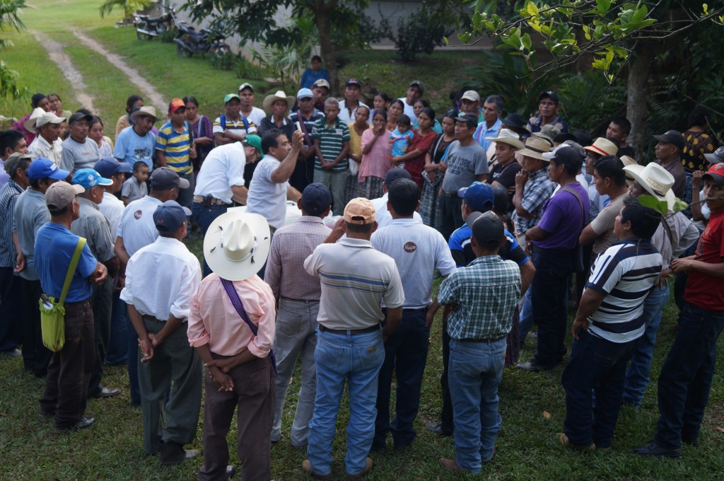 Farmers receiving technical training at a community meeting in Lachua, Guatemala.