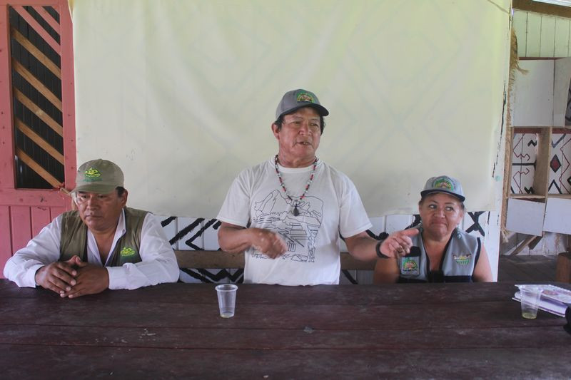 Ilson Lopez (center) says sustainable logging provides reliable income while conserving forest.